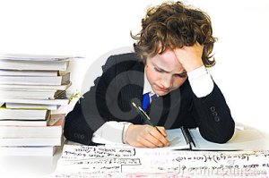 http://www.dreamstime.com/stock-images-school-boy-working-hard-image8328064